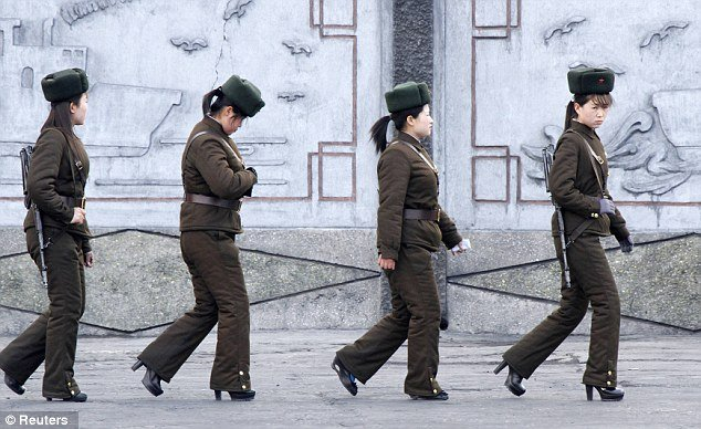 Images of four North Korean female soldiers in heels and Soviet-style hats were released in the latest act of bravado from dictator Kim Jong- un
