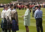 Kate Middleton, who is expecting her first baby in July, looked obviously pregnant for the first time as she attended the National Review of the Queen's Scouts at Windsor Castle
