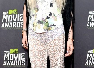 Ke$ha reinforced her position as the queen of the worst dressed lists at the MTV Movie Awards 2013, as her outfit hit all the worst trends from the decade