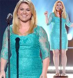 Kelly Clarkson's light blue mid sleeve mini dress appeared a tad too small on the 30-year-old American Idol star