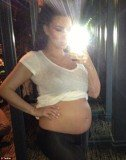 Kim Kardashian revealed her sizable belly as she hit six month mark pregnancy