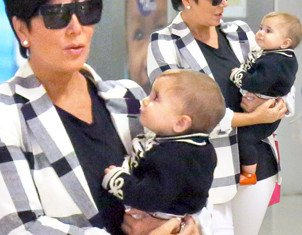 Kris Jenner carries granddaughter Penelope Disick through Greek airport