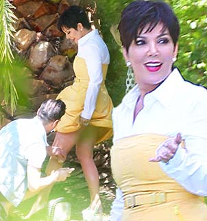 Kris Jenner was snapped having her legs touched up with what appeared to be spray tan while on a photoshoot