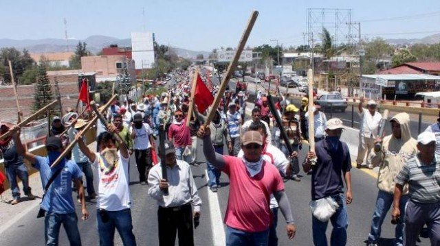 Mexican teachers incensed by sweeping education reforms have attacked the buildings of political parties in the south-western state of Guerrero