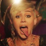 Miley Cyrus took to Twitter late Friday night with a series of snaps displaying her newly acquired rocker look