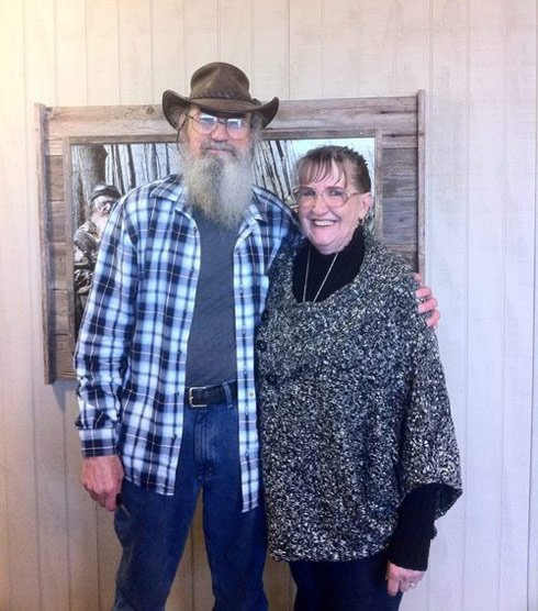 Si Robertson is married for many years to Christine who isnt featured on the Duck Dynasty reality show photo