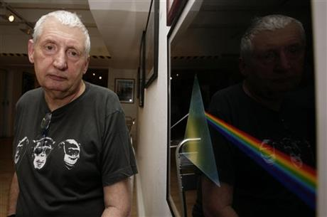 Storm Thorgerson designed the album cover showing a prism spreading a spectrum of color for Pink Floyd's The Dark Side Of The Moon
