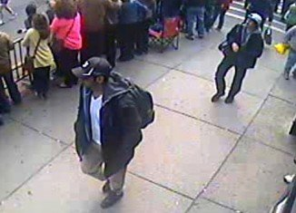 The FBI has released photos and video of two suspects they want to identify as part of the investigation into Monday's Boston Marathon bombings