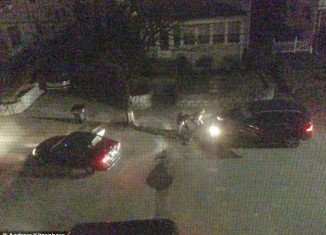 The images, taken by Andrew Kitzenberg, a resident of the Watertown street, in the early hours of Friday, show the Tsarnaev brothers sheltering behind a vehicle and clearly taking aim at police officers
