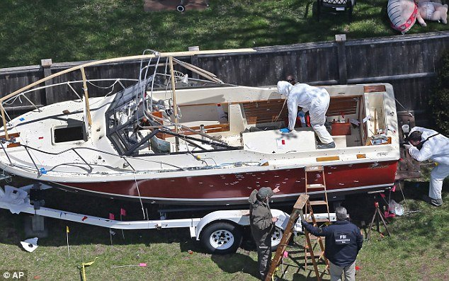 Two unnamed US officials have told the AP that Dzhokhar Tsarnaev was unarmed when police captured him hiding inside the boat