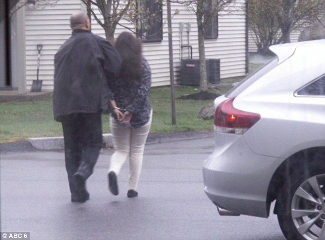 Two women one of them thought to be Dzhokhar Tsarnaev's girlfriend and one man were apprehended from the Hidden Brook Apartments on Carriage Drive in New Bedford photo