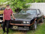 Amanda Berry's grandfather Troy Berry with the Chevrolet 1986 Monte Carlo, SS Nascar limited edition, that he promised her ten years ago