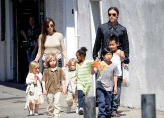 Angelina Jolie kept her family life as normal as possible for the sake of her children as she underwent a double mastectomy