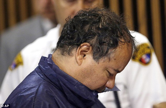 Ariel Castro 52 hung his head in shame as he made his first court appearance photo