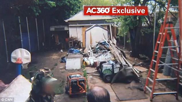 Ariel Castro had spools of barbed wired tossed about his backyard alongside heavy metal chains and rolls of tarp that he used to hide his neighbor's view