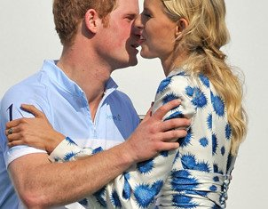 As well as being awarded a trophy for his team's stellar effort, Prince Harry also scored a kiss from model Karolina Kurkova at the end of the fast-moving polo game