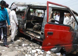 At least 16 children and their teacher have been killed when their school bus caught fire near Gujrat in eastern Pakistan