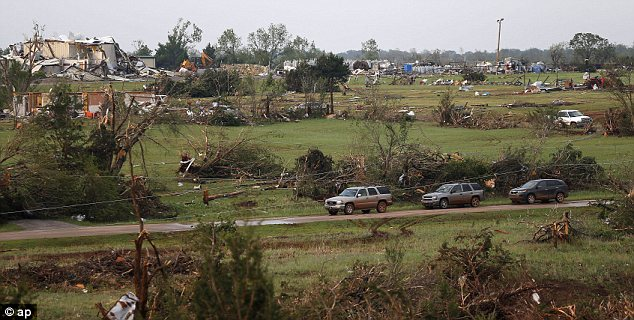 At least one person is reported dead and at least 21 others injured in a series of tornadoes that have torn through Oklahoma and Kansas.