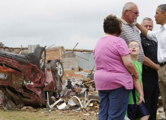 Barack Obama has visited the tornado-ravaged town of Moore in Oklahoma to comfort its victims