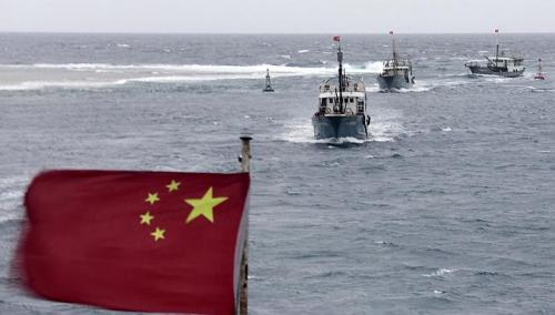 China has called on North Korea to secure the release of Yu Xuejun's fishing boat and its crew seized earlier this month photo