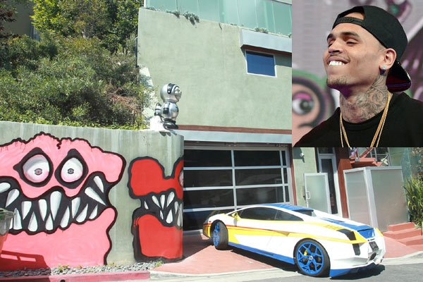Chris Brown must remove the graffiti art along the front wall of his Hollywood home after his neighbour complained about the artwork