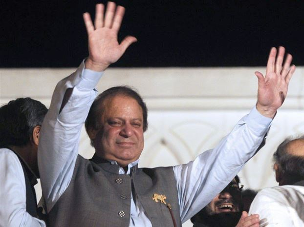 Former Pakistani Prime Minister Nawaz Sharif is celebrating with his supporters amid early signs that his party will be the largest after parliamentary elections photo