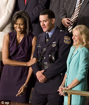 Former Philadelphia police officer Richard DeCoatsworth once hailed as a hero and given a seat next to Michelle Obama, has been arrested and charged with rape and other crimes
