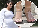 Heavily pregnant Kim Kardashian's feet were so swollen that she barely managed to squeeze them into the footwear