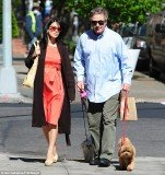 Hilaria Baldwin showed off her baby bump as she joined husband Alec Baldwin to walk their dogs in New York City