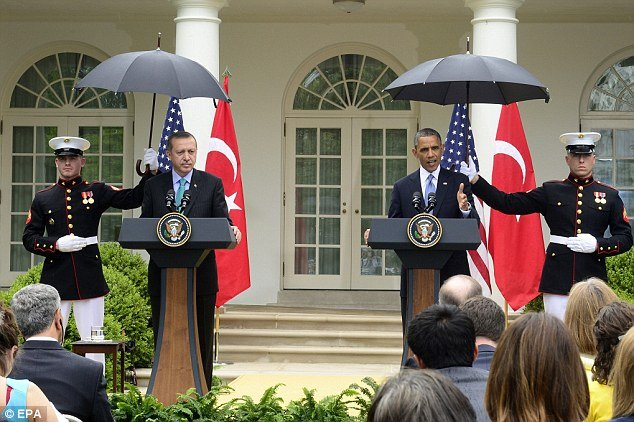 Hosting Turkish PM Recep Tayyip Erdogan in the Rose Garden, President Barack Obama requested a standing Marine to open an umbrella and protect his head from the light rain