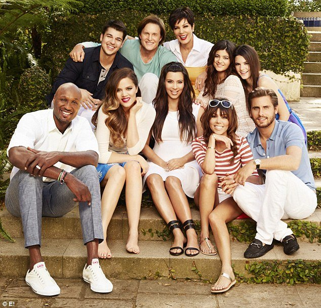 In the just-released family photo promoting the upcoming season of KUWTK, Khloe Kardashian is seated next to her husband Lamar Odom