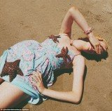 Ireland Baldwin's latest series of Twitter pictures show the teenage model with three live starfish placed on her while she reclines on a beach