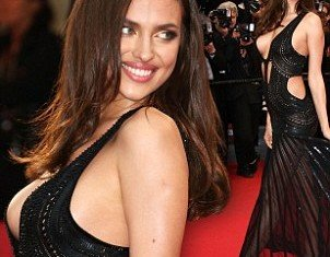 Irina Shayk almost suffered a wardrobe malfunction as she arrived on the red carpet at the All Is Lost premiere in Cannes