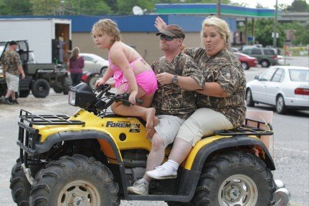"""June Shannon and Sugar Bear rode off into the sunset on an all terrain vehicle with a """"Just Married"""" sign after celebrating their nuptials in a garden ceremony photo"""