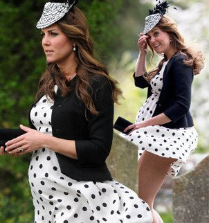 Kate Middleton was left red-faced after the gusts lifted up her polka-dot dress
