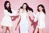 Kim, Khloe and Kourtney Kardashian's sibling rivalry reaches new levels as they all pose in angelic white for latest Kollection promo