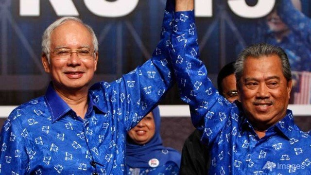 Malaysia's ruling National Front coalition has won a simple majority in the country's parliamentary election, extending its 56-year rule