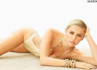 Miley Cyrus claims she tops Maxim's annual Hot 100 list stealing the crown from Israeli supermodel Bar Refaeli
