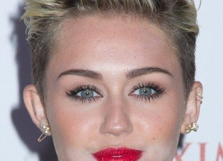 Miley Cyrus had a visible layer of white powder around her chin after suffering a make-up malfunction while glamming up to celebrate her title as Maxim's hottest woman