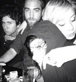 Polly Stenham with her arm draped around Robert Pattinson and another pal as they enjoyed a night out in New York City