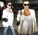 Pregnant Kim Kardashian drew attention to herself as she arrived at LAX thanks to her low-cut top