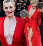 Roman Polanski's wife Emmanuelle Seigner stole the show on the red carpet in Cannes in her plunging red dress