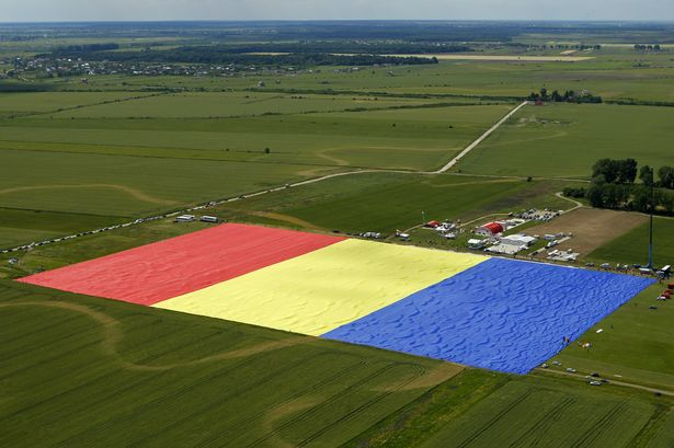 Romania broke the world record for the largest national flag making a triumphal entry in the famous Guinness World Records photo