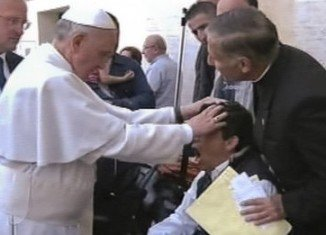 TV 2000 images show a man apparently reacting to Pope Francis putting his hands on his head