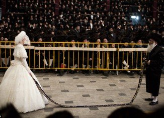 Tens of thousands of Ultra-Orthodox Jews of the Belz Hasidic Dynasty watch the wedding ceremony of Rabbi Shalom Rokach