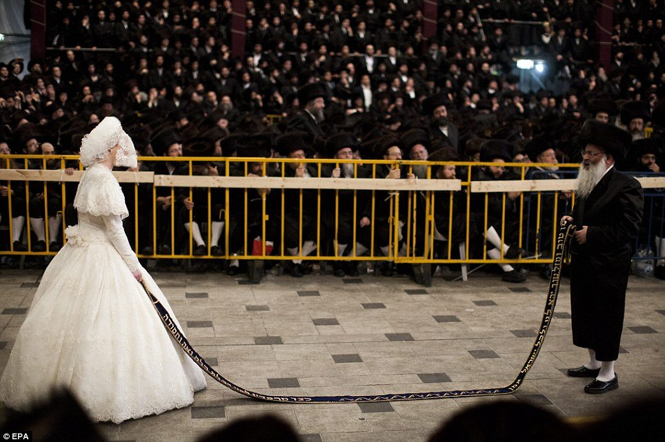 Tens of thousands of Ultra Orthodox Jews of the Belz Hasidic Dynasty watch the wedding ceremony of Rabbi Shalom Rokach - Traditional Wedding Cloth