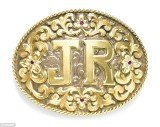The centerpiece of the items owned by Larry Hagman is a silver-and-gold belt buckle engraved with the initials of his character J.R. Ewing