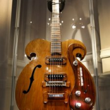 The guitar played by John Lennon and George Harrison of the Beatles has sold for $408,000 at auction