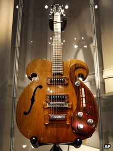 The guitar played by John Lennon and George Harrison of the Beatles has sold for 408000 at auction photo