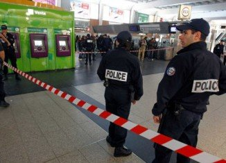 The soldier was on patrol in the area of La Defense when he was stabbed in the neck by an unknown man who escaped